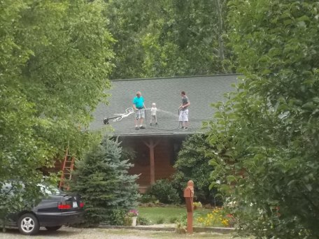 062015 Neighbors on their roof