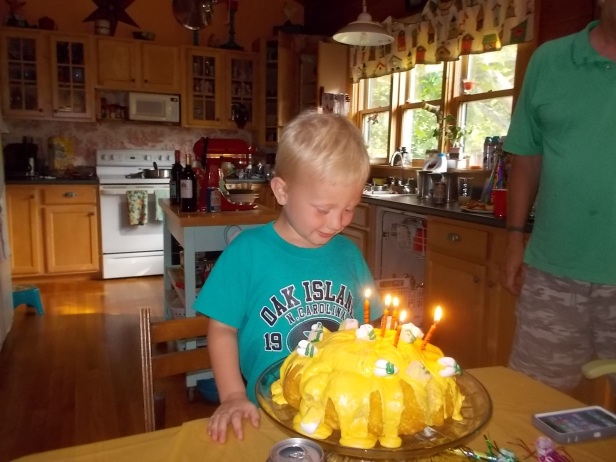 062415 Logan with honey pot cake