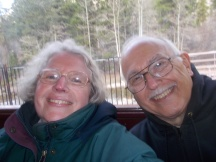 Anne and John ride the train