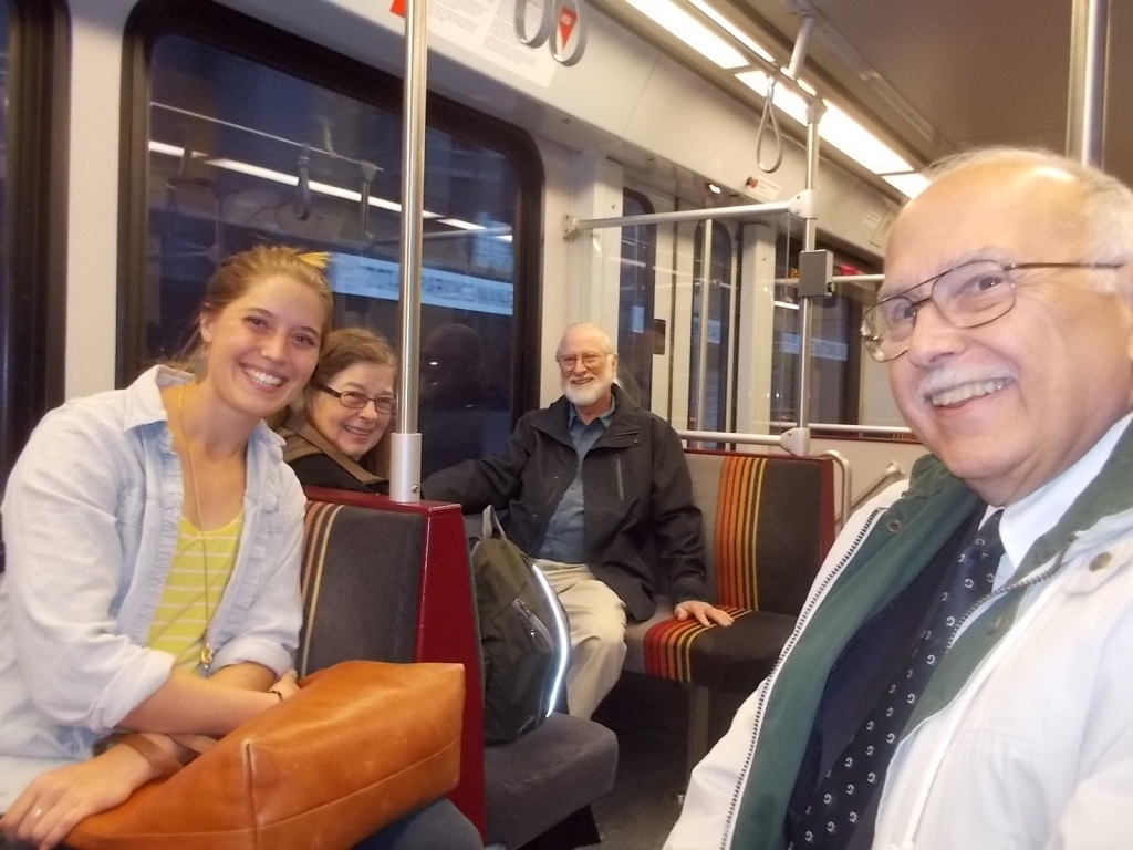 Anna, Janet, Tom, and John in the light rail car