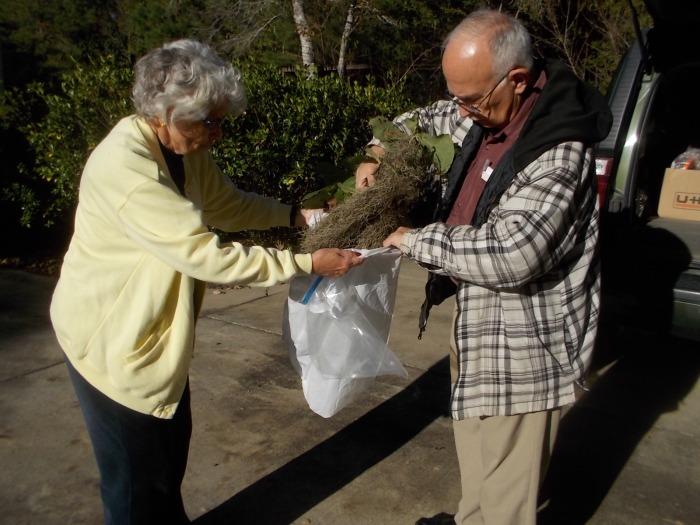 Chris holds the bag for John