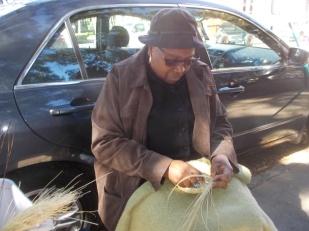 111415 Woman weaving sweetgrass basket in Charleston
