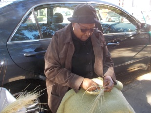 111415 Woman weaving sweetgrass basket in Charleston