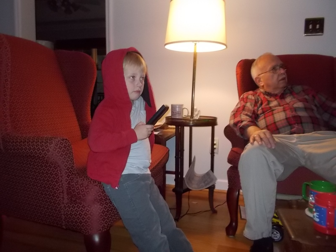 120915 Logan with remote.JPG