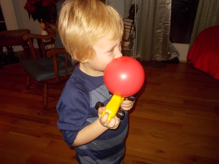 122815 Logan blows balloon for car.JPG