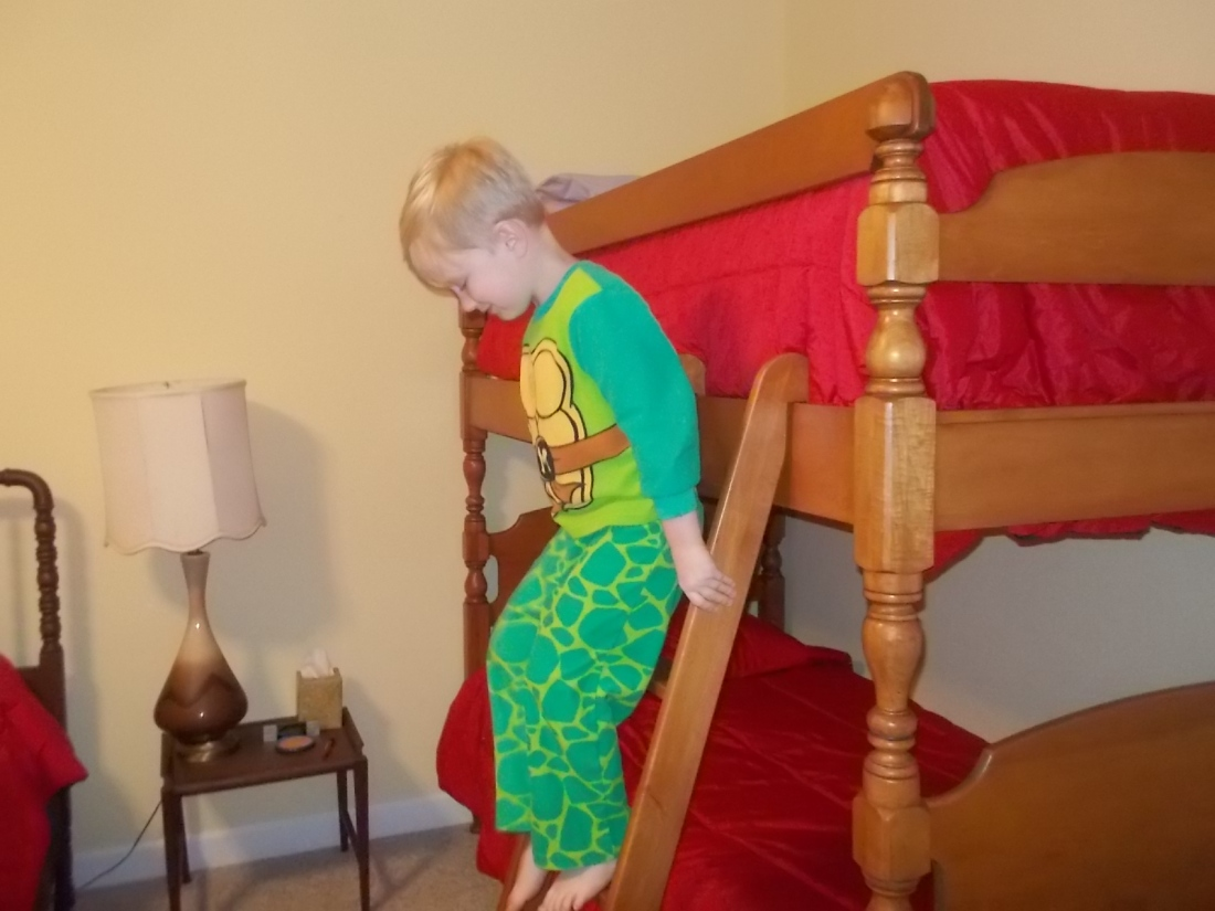 041716 Logan changes his mind about the top bunk.JPG