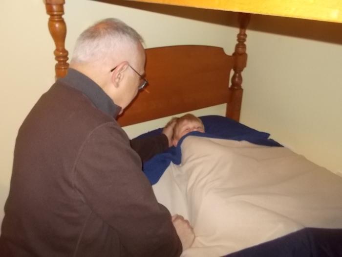 041716 Logan prays with John.JPG