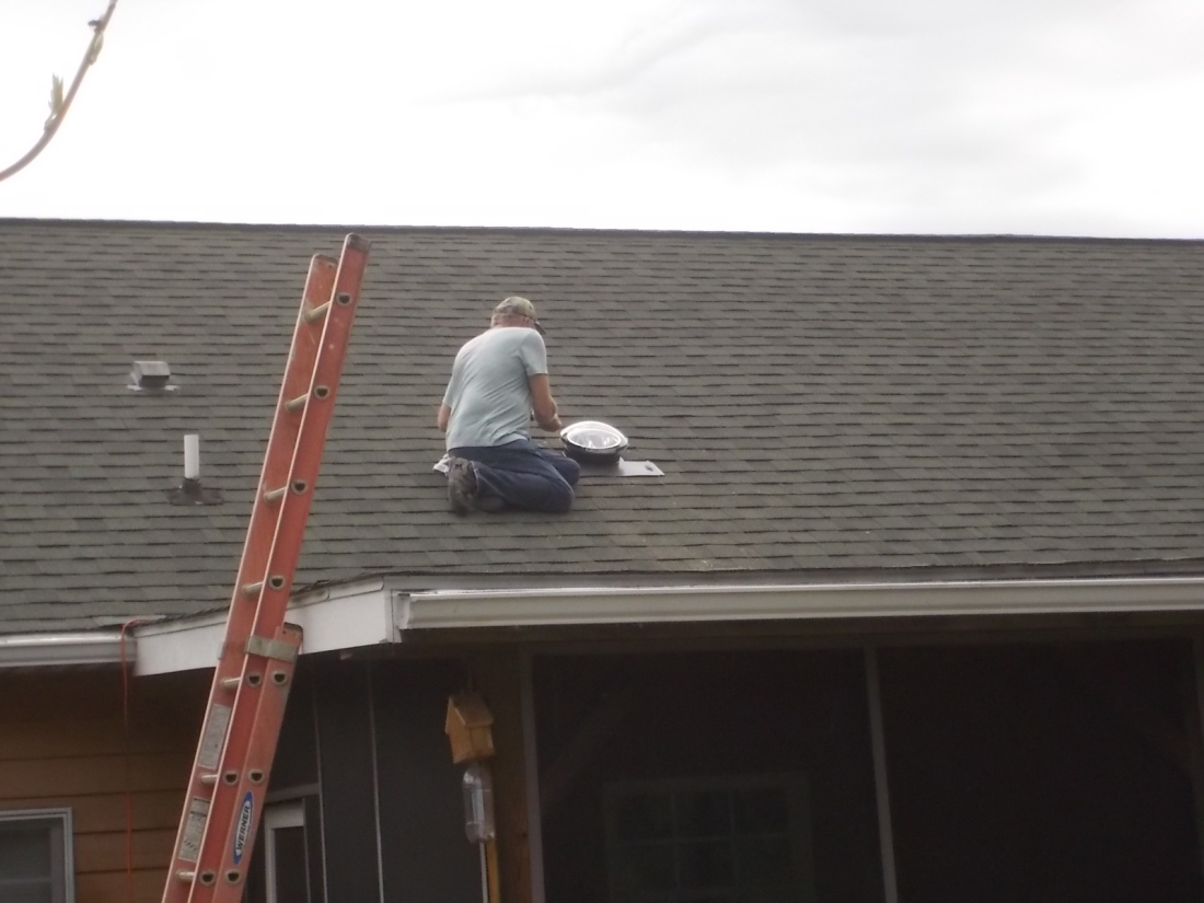 051616 Bob finishing solar tube on roof.JPG