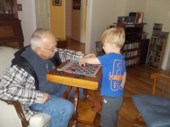 051616 John and Logan play checkers.JPG