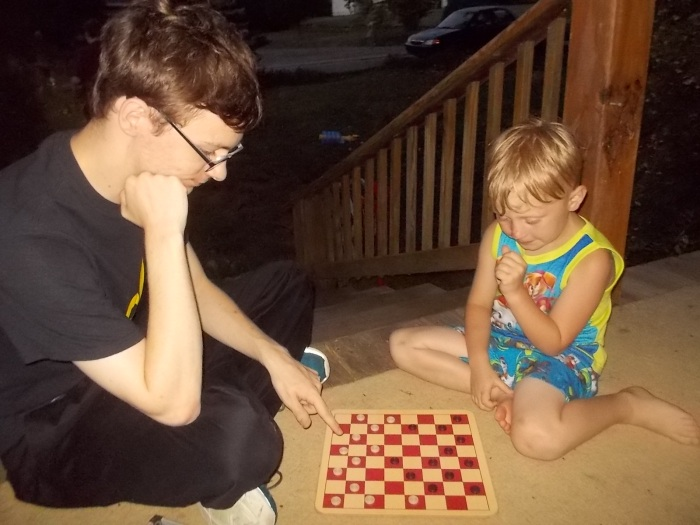 062416 D and Logan play checkers.JPG