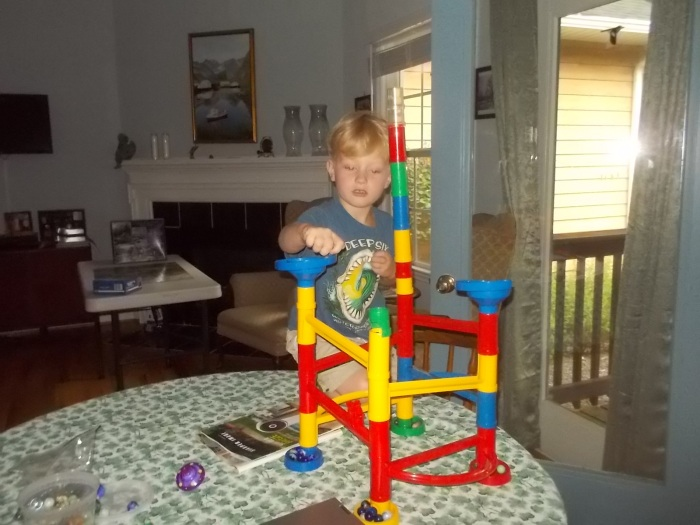 072116 Logan plays with D's marbles.JPG