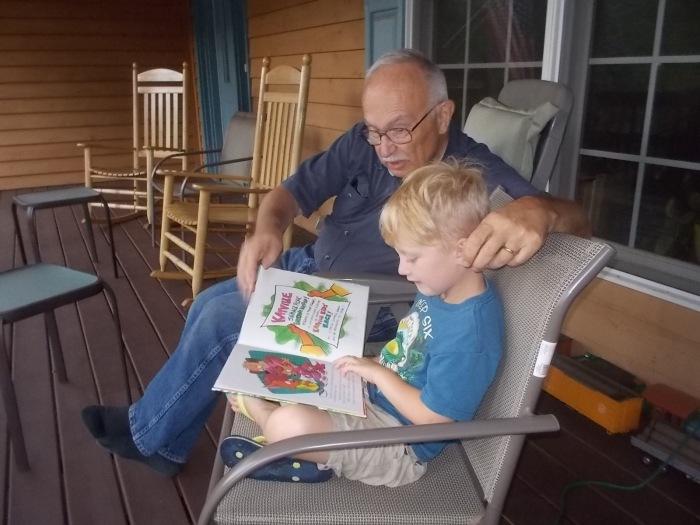 072116 Logan reads to Grandpa John.JPG