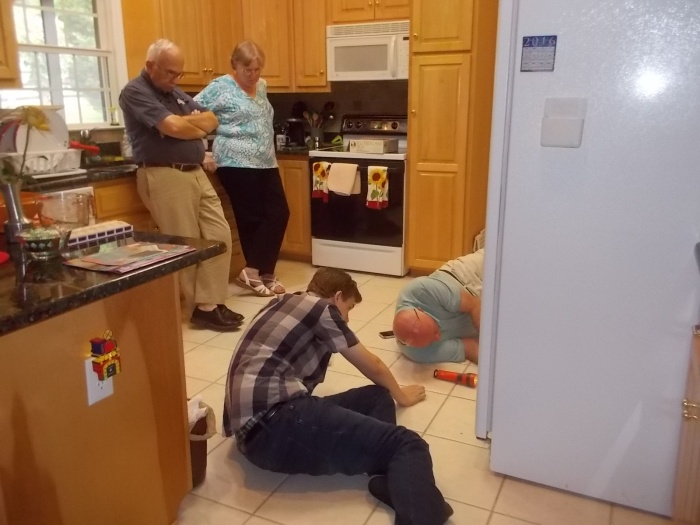 080616 Fridge repairers and two supervisors.jpg