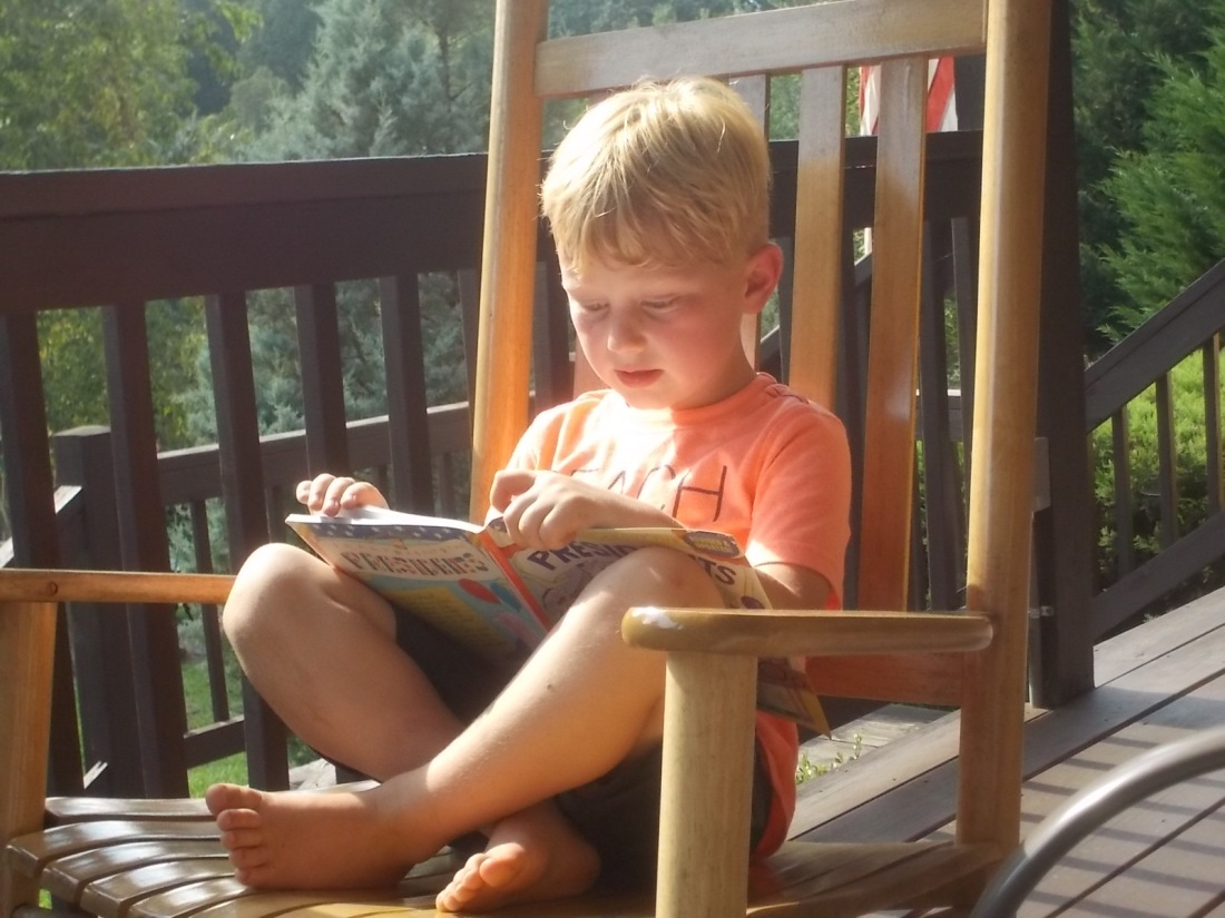 082416 Logan reads Barbara's book.jpg