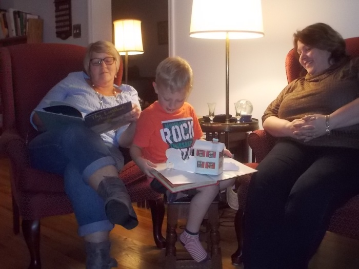 112916 Logan reads Night Before Xmas to Shawn and Lise.JPG
