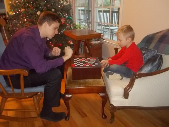 122916 N Logan play checkers.JPG