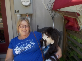Shawn with big doll outside shop