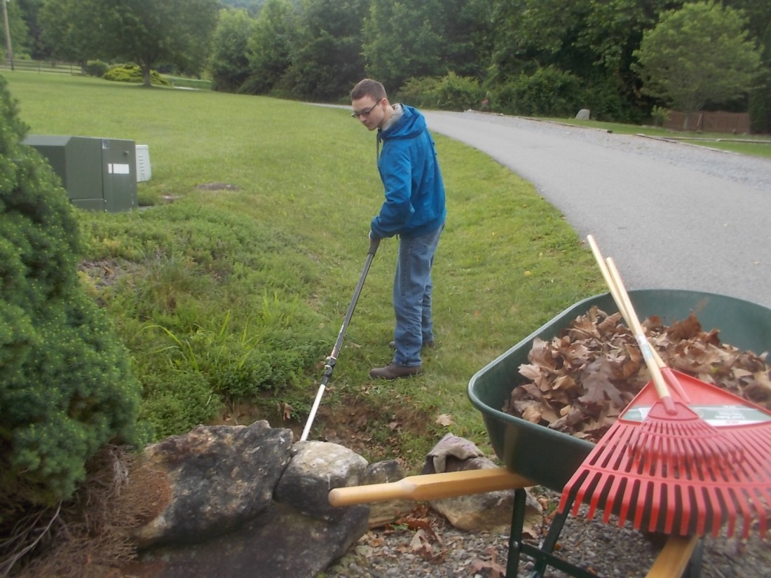060817 David cleans driveway pipe.JPG