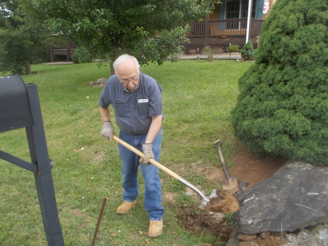 060817 John digs out pipe.JPG