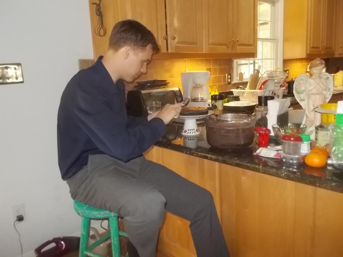 061917 N icing David's cake.jpg