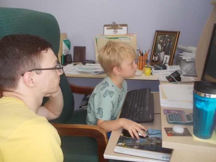 071417 David and Logan play a computer game.jpg