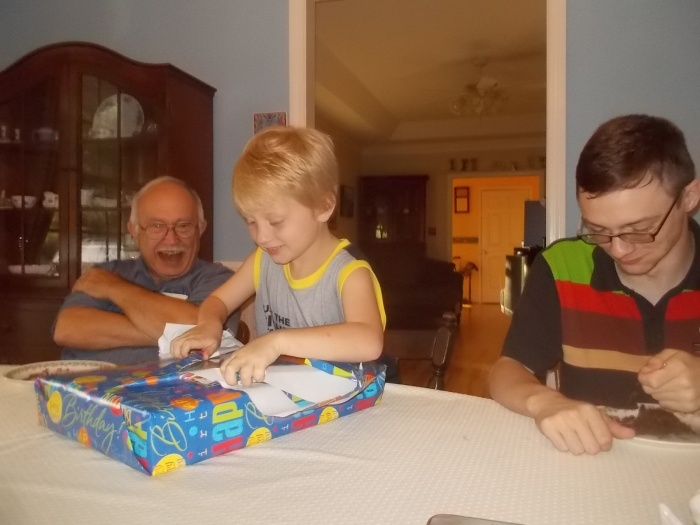 072417 Logan opens his gift.jpg