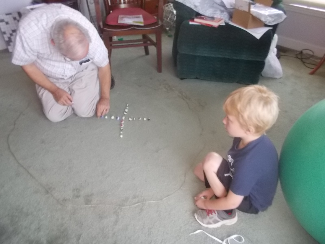 072517 Setting up game of marbles.jpg