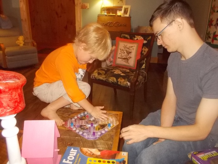081117 Logan plays game with David.jpg