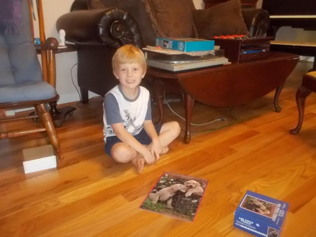 081717 Logan finishes puzzle.jpg