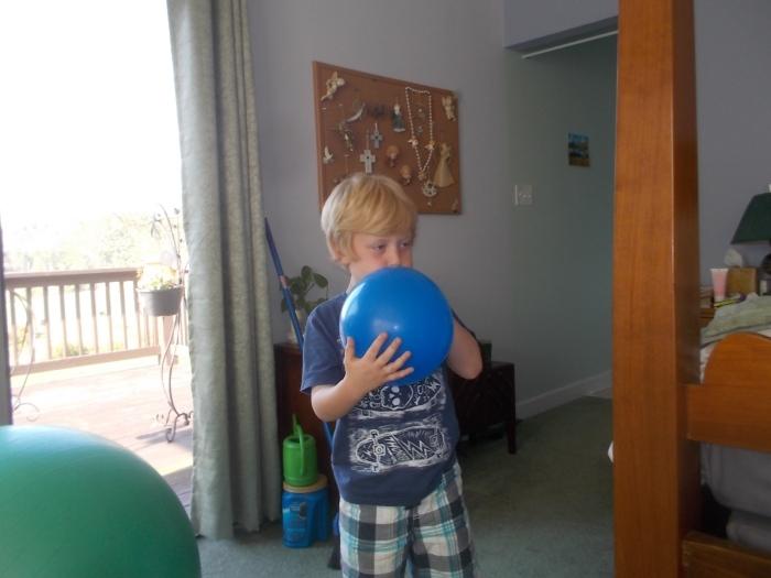 092817 Logan blows up a balloon.jpg