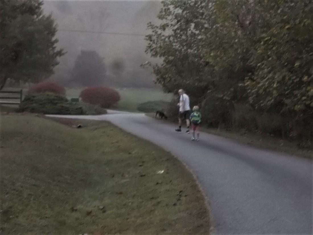 092917 1 Bob and Logan walk to the bus.jpg