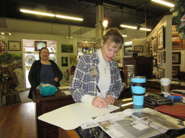 021718 Artist signs placemats Julie bought.JPG