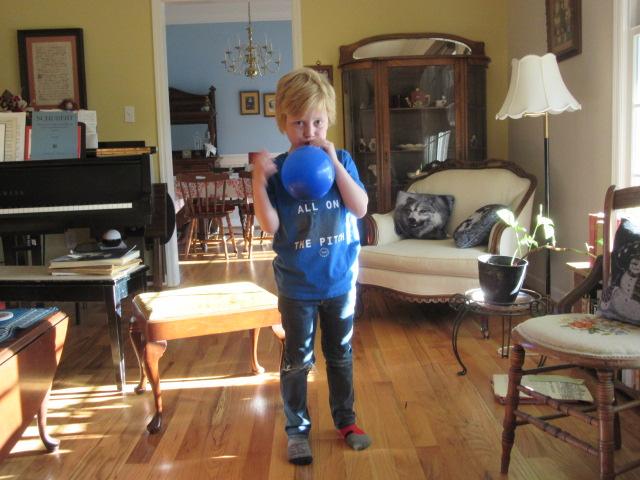 022618 Logan blows up a balloon.JPG