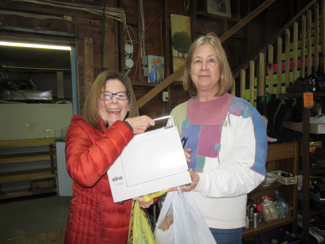 022818 Karen at thrift shop with volunteer.JPG