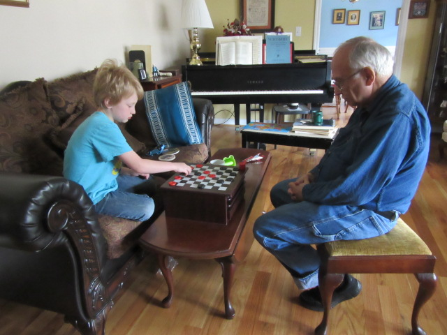 032118 (3) Logan plays checkers with John.JPG