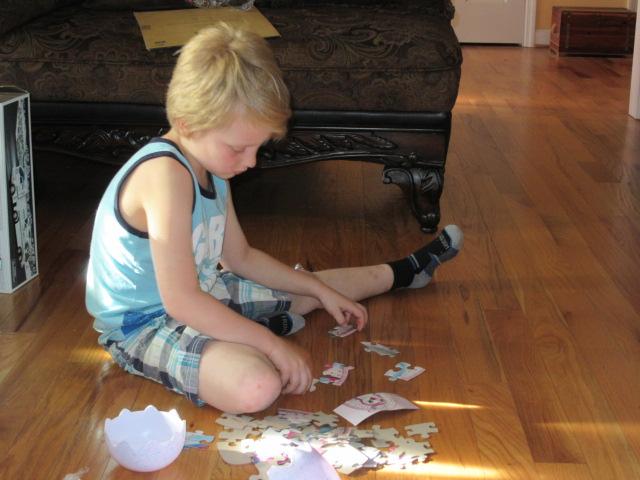 040118 Logan works Easter puzzle.JPG