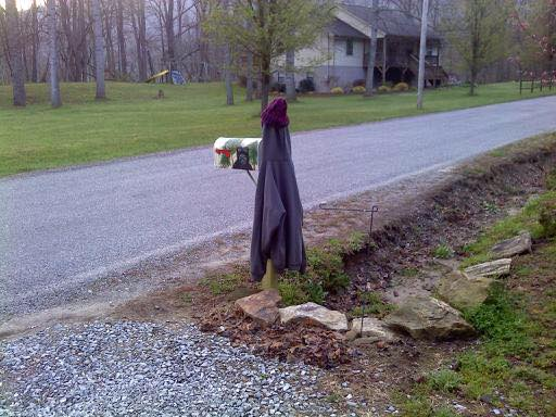 040318 Marla's take on my jacket warming her mailbox.jpg