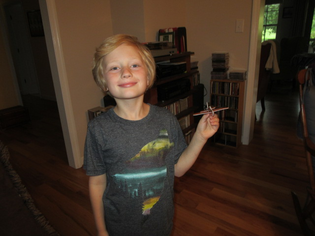 052818 Logan with mini-airplane.JPG