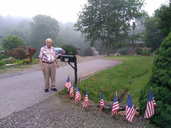 061418 John at our mailbox on Flag Day.jpg