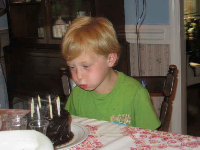 061918 Logan blows out candles.JPG