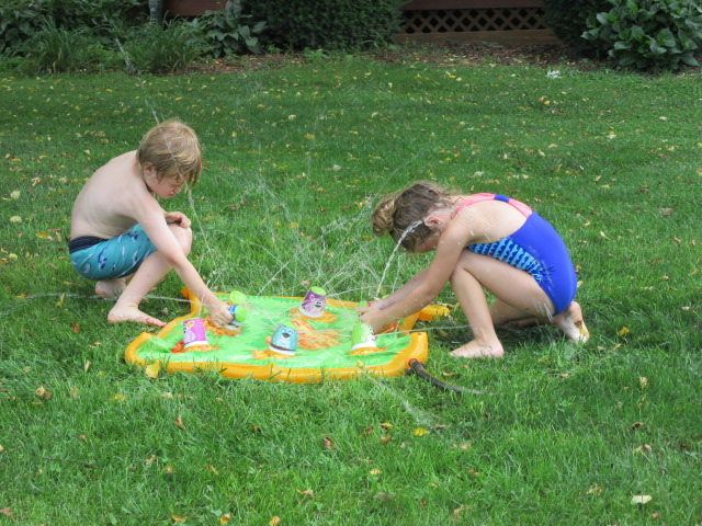 062018 Logan and Lily play with water mat.JPG