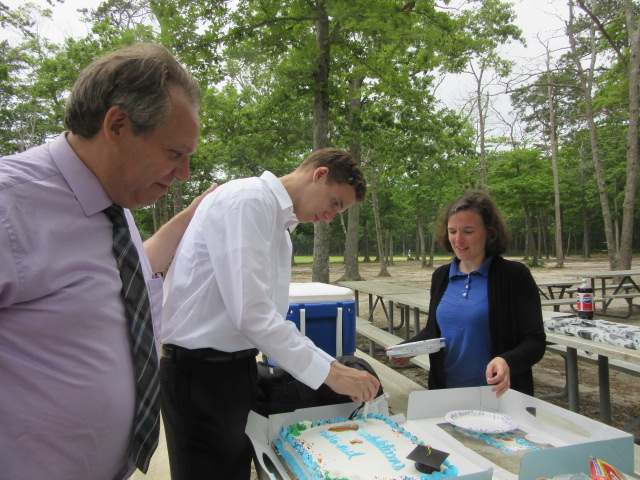 062418 Peter Kate watch Nate cut cake.JPG