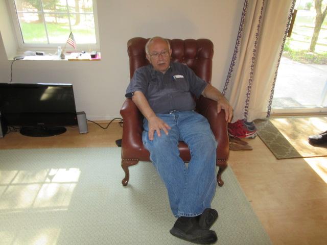 062618 John sprawled in his old chair.JPG