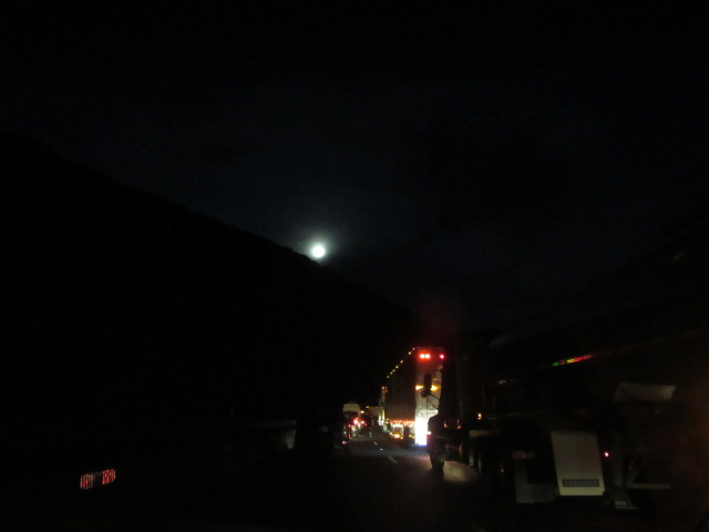 062618 Moon rising in the gorge over stopped traffic on I-40.JPG