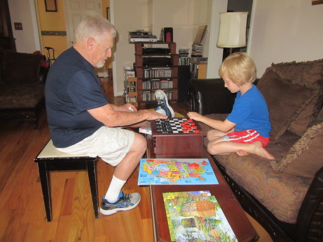 070418 Ron plays checkers with Logan.jpg