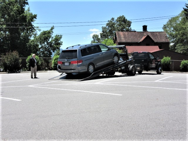 070818 John watches car being pulled on the truck.JPG