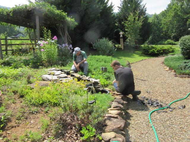 071118 First repairs to backyard waterfall.JPG