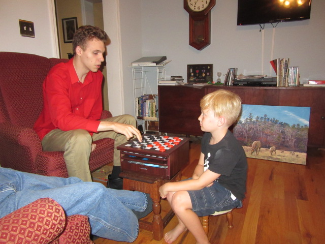 072318 N plays checkers with Logan.JPG