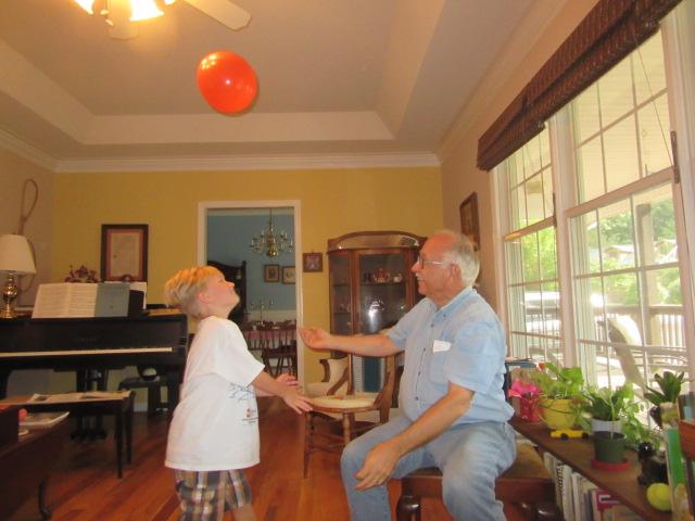 083018 Logan John batting a balloon.JPG