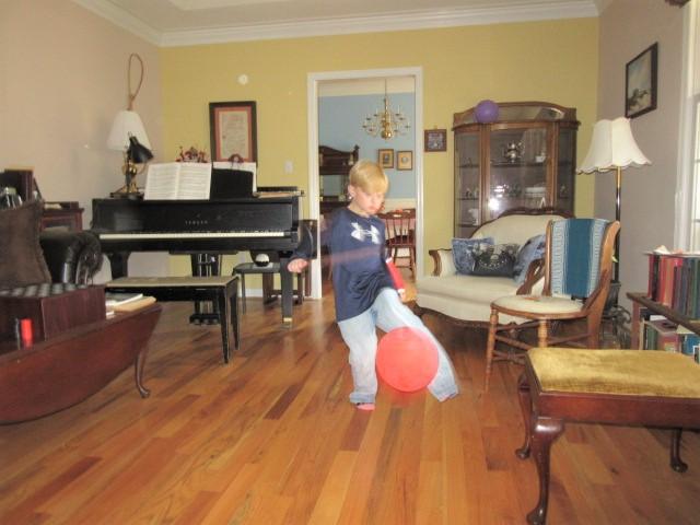 110618 Logan is a blur playing balloon.JPG